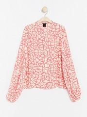 Kuvioitu pusero, jossa pallohihat Vaaleanpunainen