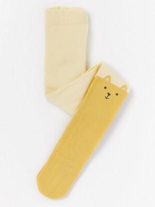 Sukkahousut, jonka polvissa nallet Keltainen