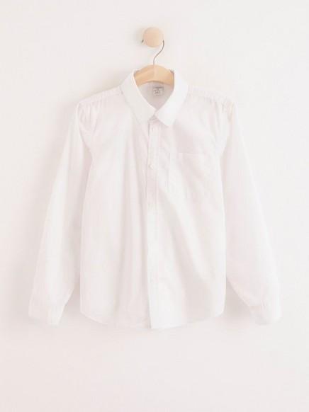Valkoinen pusero, jossa on rintatasku Valkoinen