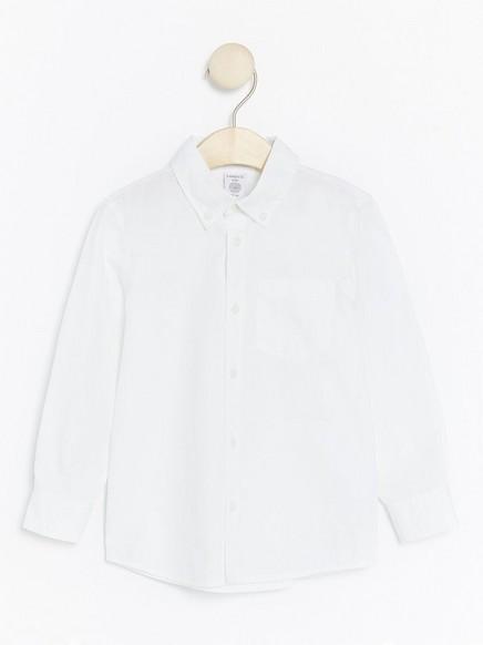 Valkoinen pusero Valkoinen
