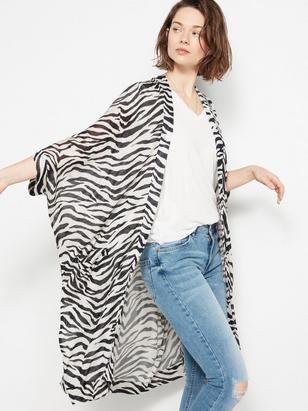 Lång zebramönstrad kofta Beige