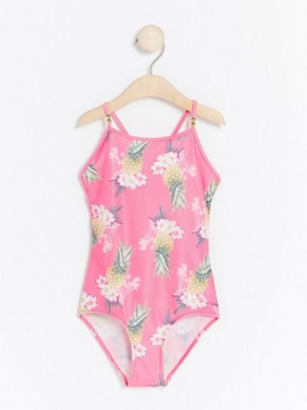 Vaaleanpunainen uima-asu, jossa ananaspainatus Vaaleanpunainen