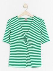 Jerseytopp med V-hals i lyocellblanding Grønn