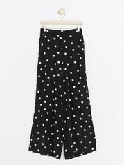 Široké puntíkované kalhoty Černá