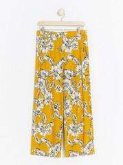 Vzorované kalhoty se širokými nohavicemi Žlutá