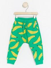 Byxor med bananmönster Grön