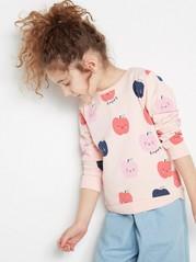 Vaaleanpunainen pusero, jossa omenoita Vaaleanpunainen