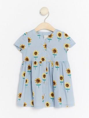 Šaty smotivem slunečnic Modrá
