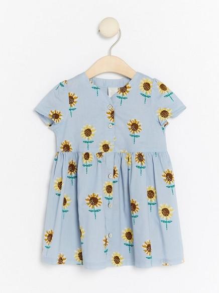 Mekko, jossa auringonkukkia Sininen