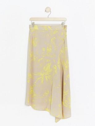 Mönstrad, asymmetrisk kjol Gul