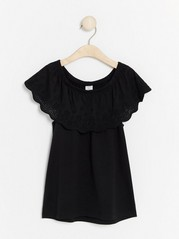 Top with Hole-embroidery and Flounce Black