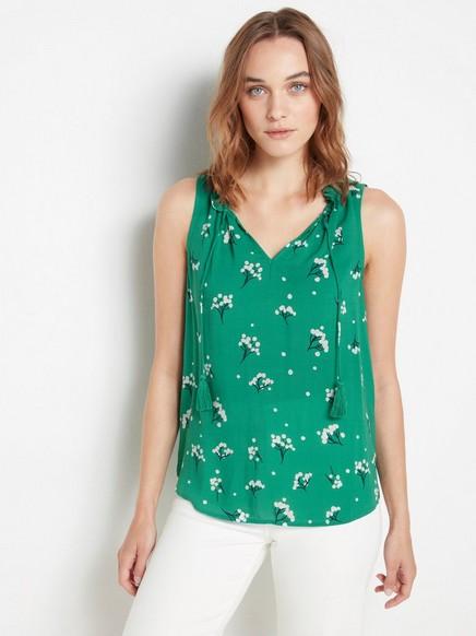 Ermeløs bluse med dusker Grønn