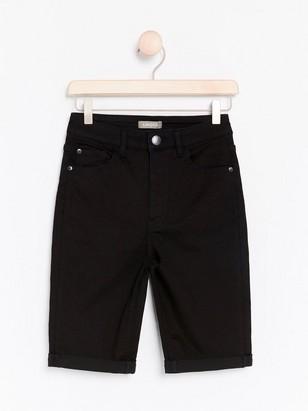 Svarta jeansshorts med hög midja  Svart