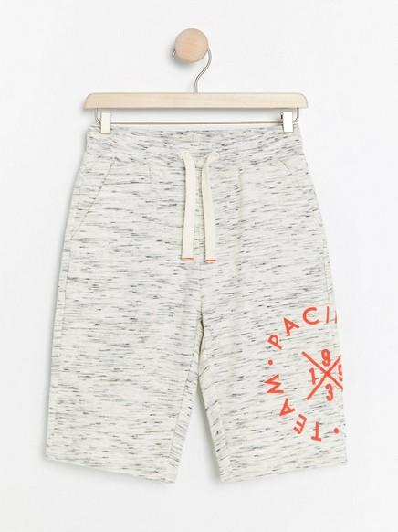 Shorts i collegemateriale med trykk Beige