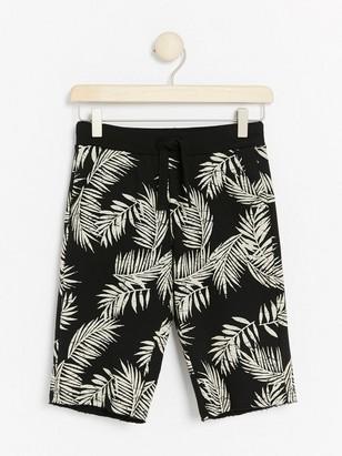 Mønstret shorts i collegestoff Svart
