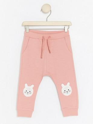 Kalhoty skrálíčky na kolenou Růžová