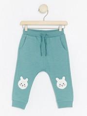 Kalhoty skrálíčky na kolenou Tyrkysová
