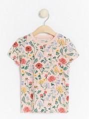 Lyhythihainen pusero, jossa kukkakuviointi Vaaleanpunainen