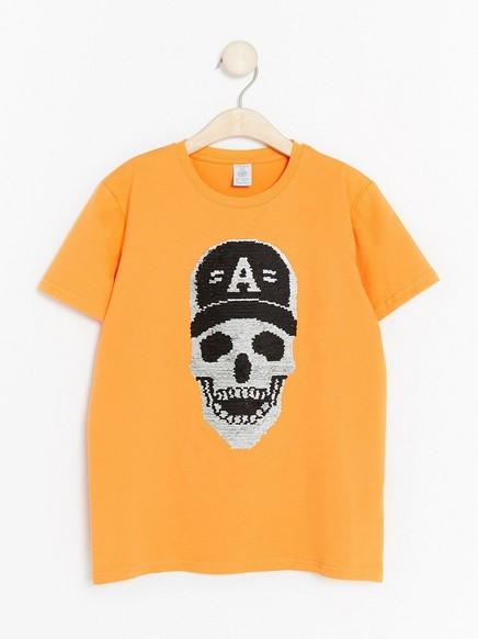 T-paita, jossa on käännettävät paljetit Oranssi