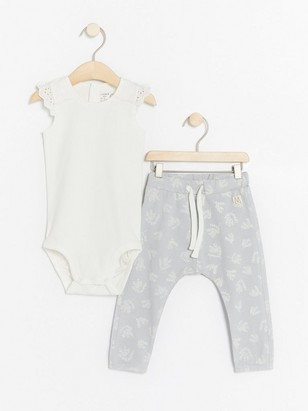 Set with sleeveless bodysuit and patterned trousers White