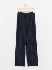 BELLA – tummansiniset rennot housut Sininen