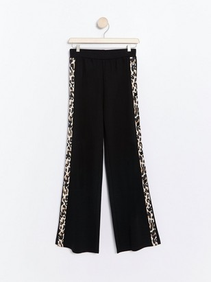 Wide jersey trousers with leo print side stripes Black