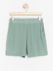 Green shorts with dots  Green
