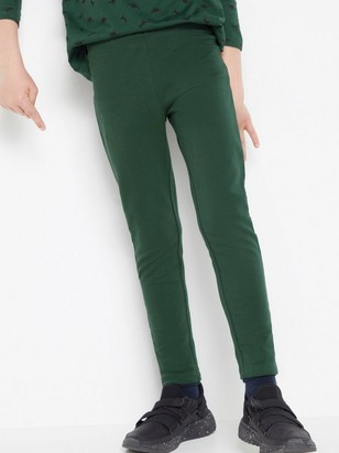 Tummanvihreät leggingsit, joissa harjattu sisäpuoli Vihreä