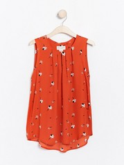 Ermeløs, mønstret bluse Oransje
