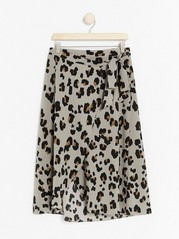 Beige leo patterned wrap skirt  Brown
