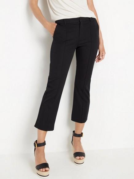 Leveälahkeiset nilkkapituiset housut Musta