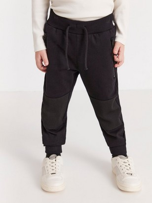 Black sweatpants with mesh patches on knees Black