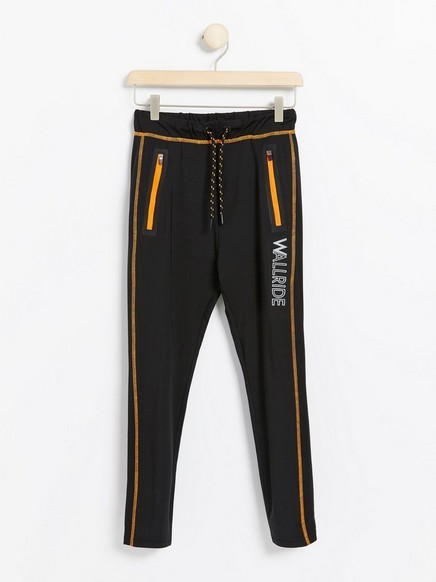 Sports pants with neon coloured details Black