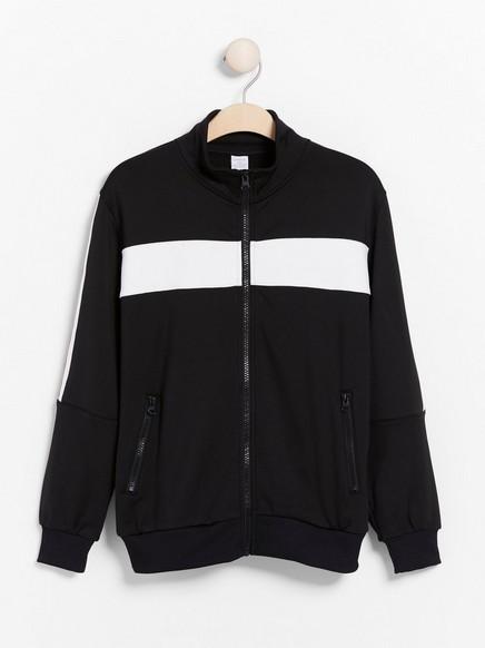 Svart WCT-jakke med glidelås og striper på sidene Svart