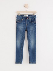 Slim fit jeans i denimjersey Blå