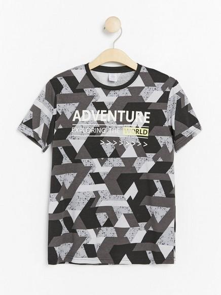 T-paita, jossa abstrakti kuvio ja painatus Musta