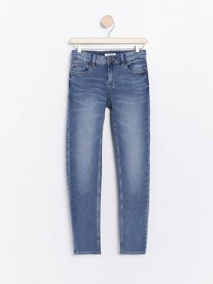 Slim fit jeans i denimjersey Blå