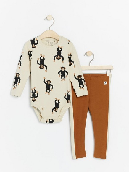 Set with bodysuit with monkeys and brown leggings Beige