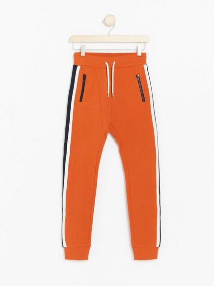 Orange sweatpants with side stripes Orange