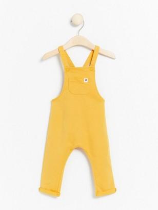 Žluté kalhoty slaclem Žlutá