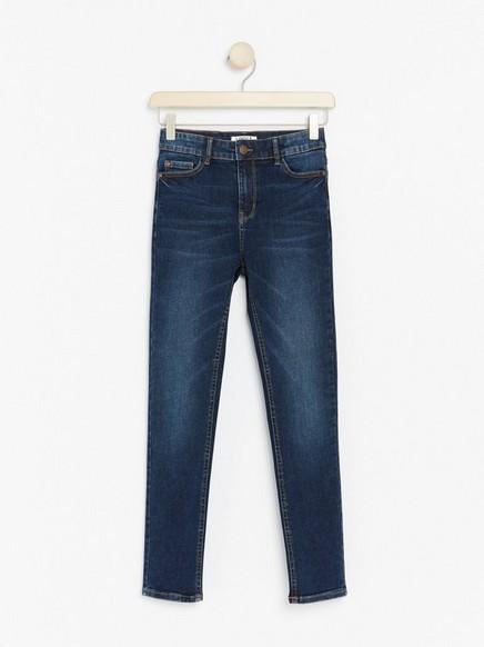 Mørkeblå, smal bukse med høyt liv med ekstra stretch Blå