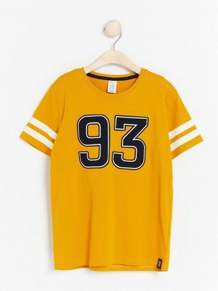 Kortärmad t-shirt med tryck Gul