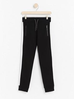 Black sweatpants with white side stripes Black