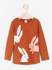 Dark orange top with rabbit print Orange