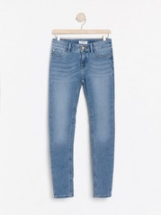Jeans med smal passform og børstet innside Blå