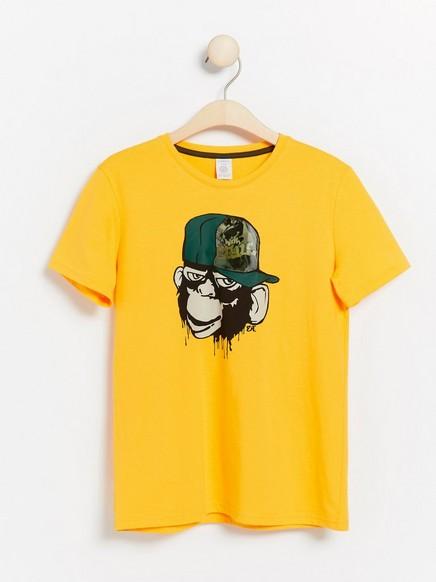 T-paita, jossa apinapainatus ja hologrammi Keltainen