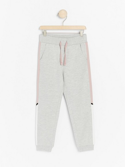 Grey sweatpants with side stripes in pink and white Grey