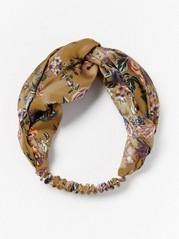 Blommönstrat hårband i satin  Gul