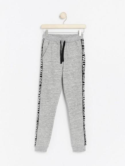 Grey melange sweatpants with side stripes Grey