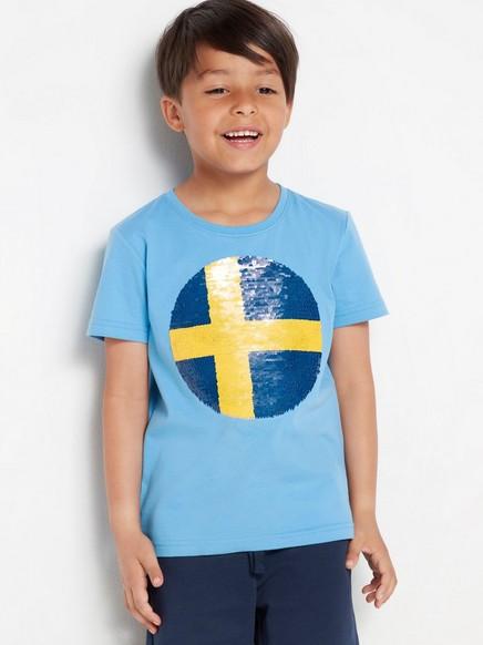 Sininen t-paita, jossa käännettävistä paljeteista tehty jalkapallo Keltainen